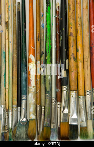 Well used artists oil painting brushes close-up background - Stock Photo