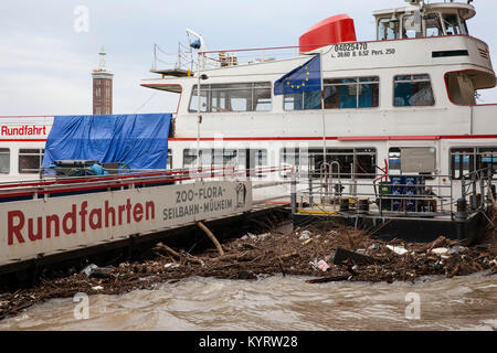 Cologne, Germany, 10. January 2018, flood of the river Rhine, flotsam at a landing stage.  Köln, Deutschland, 10. - Stock Photo