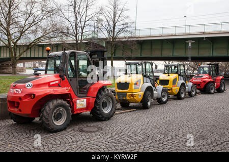 Europe, Germany, North Rhine-Westphalia, Cologne, forklifts on the banks of the river Rhine, Deutzer bridge.  Europa, - Stock Photo