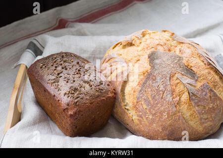 Homemade wholemeal bread handicraft - Stock Photo