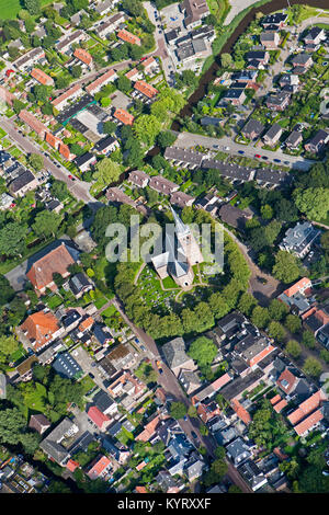 The Netherlands, Wirdum, Center of village. Church constructed on mound, formerly a refuge in times of flooding. - Stock Photo