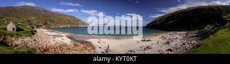 Panoramic view of holidaymakers in the sun onthe beach at Keem Bay, Achill Iland on the west coast of Ireland - Stock Photo