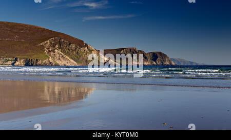 Cliffs reflecting in wet sand on Keel beach, Achill Island, Ireland - Stock Photo