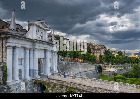Clouds over the Porta San Giacomo-old city gate in the beautiful medieval town of Bergamo, Upper City (citta alta), - Stock Photo