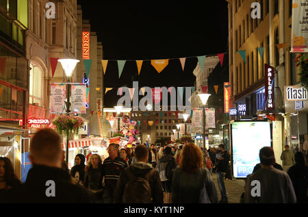 MALMO, SWEDEN - AUGUST 16, 2016: View of beautiful night scene and people walk on pedestrian street - Sodergatan - Stock Photo