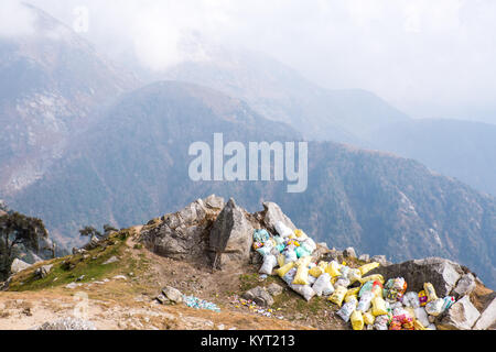 Trekker's waste piled up in plastic sacks in the Himalayan foothills, India - Stock Photo