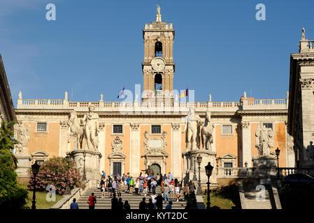 italy, rome, capitoline hill, piazza del campidoglio, statues of castor and pollux and palazzo senatorio - Stock Photo