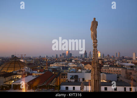 Skyline of Milan with the modern skyscrapers of Porta Nuova, seen from the top of the Cathedral, Italy - Stock Photo