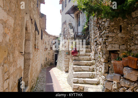 Narrow ancient street and stairs in old European town of Eze near Nice France Cote d'Azure with white rocks and - Stock Photo
