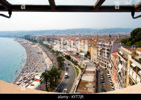 Amazing tourists bird's-eye viewpoint overlooking blue Mediterranean sea beach with palm trees and bright colorful - Stock Photo