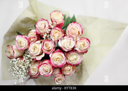 Beautiful bouquet of  red and white roses with baby's breath shot from above. Selective focus on tips of roses with - Stock Photo