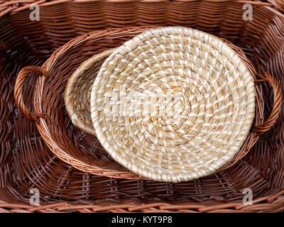 Pile of wicker baskets on sale in public street market. - Stock Photo