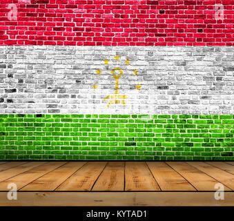 Tajikistan flag painted on brick wall with wooden floor - Stock Photo
