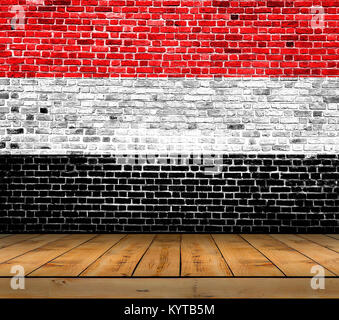 Yemen flag painted on brick wall with wooden floor - Stock Photo