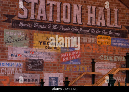 Painted advertising signs on a brick wall at National Railway Museum,York North Yorkshire,England,UK. - Stock Photo
