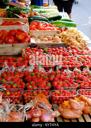 Mixed home grown foodstuffs displayed on a market stall in the Dordogne, France - Stock Photo