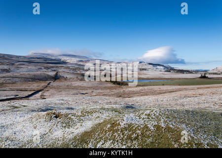 Wild Boar Fell at the head of the Eden Valley in Cumbria near Ravenstonedale, covered in snow. - Stock Photo