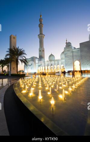 ABU DHABI, UNITED ARAB EMIRATES - DEC 31, 2017: Exterior of the Sheikh Zayed Mosque in Abu Dhabi in twilight. It - Stock Photo