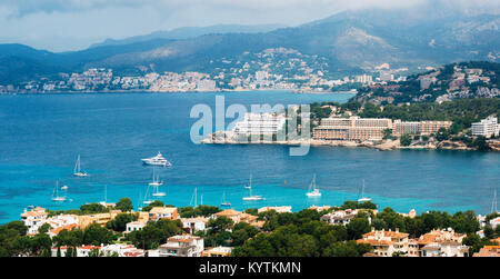 Beautiful panoramic view from above of Santa Ponsa resort, the beach with white sand, sunbeds, hotels and yachts, - Stock Photo
