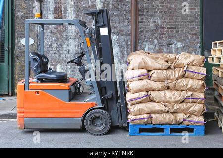 Forklift With Potato Sacks at Pallet - Stock Photo