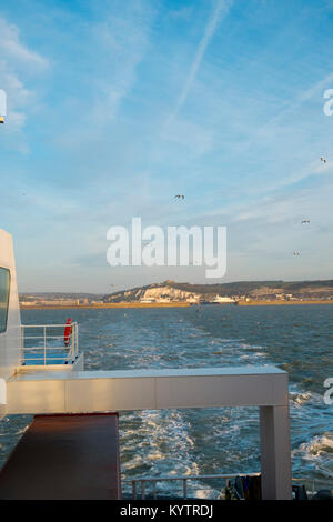 Early morning spring sunshine as a cross channel ferry departs the Port of Dover, Kent, UK heading for Calais, France - Stock Photo