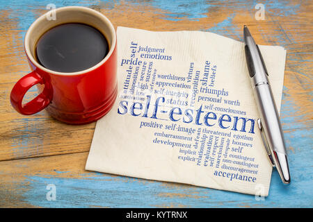 self-esteem word cloud - handwriting on a napkin with cup of coffee - Stock Photo