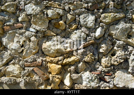 Full frame texture background of an old rubble stone wall construction - Stock Photo