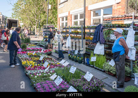 Columbia Road Flower Market stall with market traders - Stock Photo
