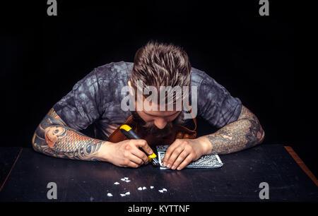Leather Artisan focusing on his work - Stock Photo
