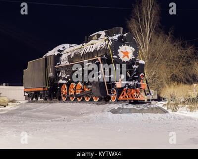 old steam locomotive on pedestal - Stock Photo