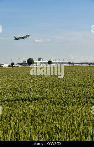 Field, airport area, satellite building, with Eurowings airplane taking off, Airbus, A320, Munich Airport, - Stock Photo