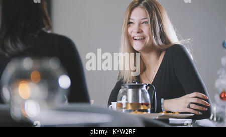 Portrait of pretty blonde young woman in cafe - Stock Photo