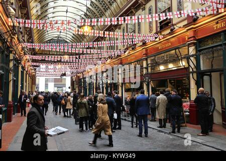 LONDON, UK - APRIL 22, 2016: People celebrate Saint George's Day in Leadenhall Market, London. Saint George is the - Stock Photo