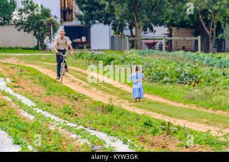 Young girl in the garden in Amish Country in Pennsylvania, USA - Stock Photo