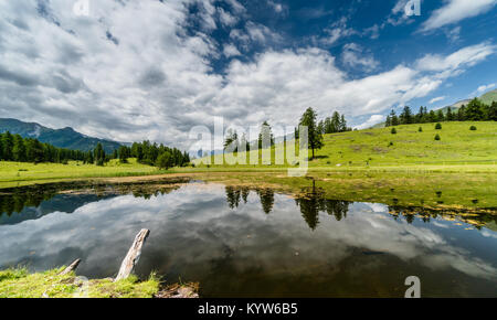 beautiful mountain landscape with a dark water mountain lake and reflections - Stock Photo