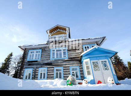The wooden house is the residence of the archimandrite on the Solovetsky Islands. Russia, Arkhangelsk region, Solovki - Stock Photo