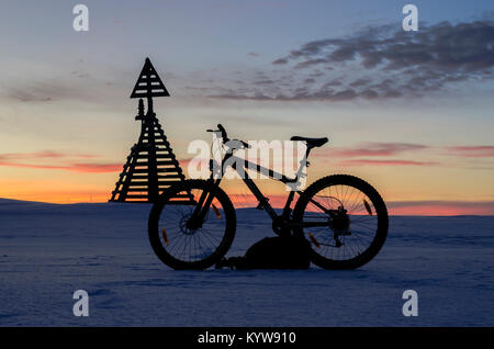 Bicycle on the background of the lighthouse and sunset - Stock Photo
