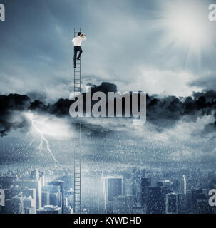 Businessman on a ladder escapes from crisis and looking for a new way - Stock Photo