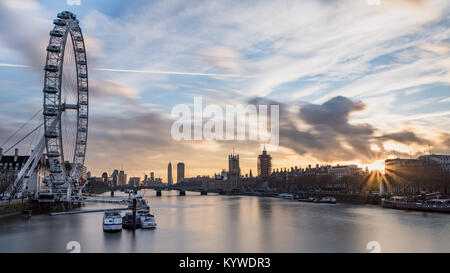 London eye, covered up Big Ben, Westminster Bridge and Parliament House during sunset by the River Thames - Stock Photo