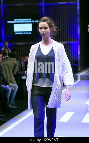 Hong Kong, China. 16th Jan, 2018. A model presents a creation during the Hong Kong Fashion Week for Fall/Winter - Stock Photo