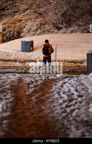 Newtownabbey, Northern, Ireland. 16th Jan, 2018. man walking home from work in amber weather warning as heavy snowfall - Stock Photo