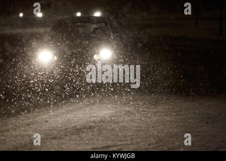 Newtownabbey, Northern, Ireland. 16th Jan, 2018. car driving through snow falling during amber weather warning as - Stock Photo