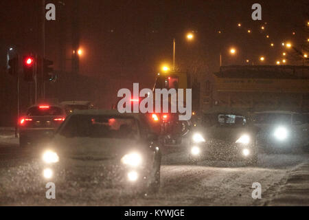 Newtownabbey, Northern, Ireland. 16th Jan, 2018. Gritter lorries attempt to clear roads during amber weather warning - Stock Photo