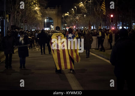 Jan 16, 2018. Barcelona, Catalonia, Spain - People wrapped with estelades or pro-independence flags during a demonstration - Stock Photo