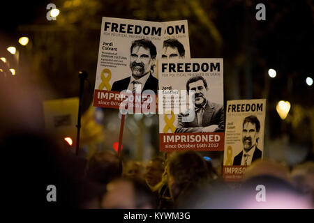 Jan 16, 2018. Barcelona, Catalonia, Spain - People hold banners showing Jordi Sanchez and Jordi Cuixart during a - Stock Photo