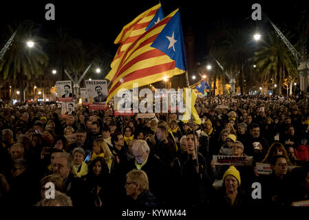 Jan 16, 2018. Barcelona, Catalonia, Spain - Demonstrators hold banners and estelades or pro-independence flags  - Stock Photo