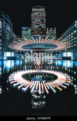 London, UK. 15th Jan, 2018. Winter Lights Festival in Canary Wharf - Halo seems to levitate above the fountain creating - Stock Photo