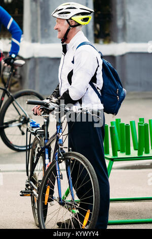 Gomel, Belarus - April 10, 2016: Adult male with bicycle at the opening of the cycling season - Stock Photo