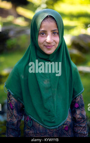 Sonamarg, Jammu & Kashmir - August 11 2017: A traditional muslim Kashmiri girl with hijab at thajiwas glacier . - Stock Photo
