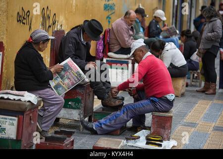 Otavalo, Ecuador - December 30, 2017: shoe shine services along the street of the indigenous town - Stock Photo